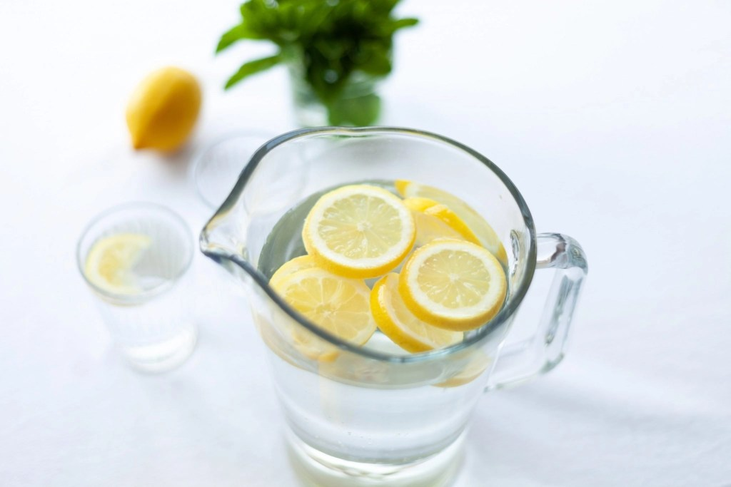 Glass pitcher of lemon water