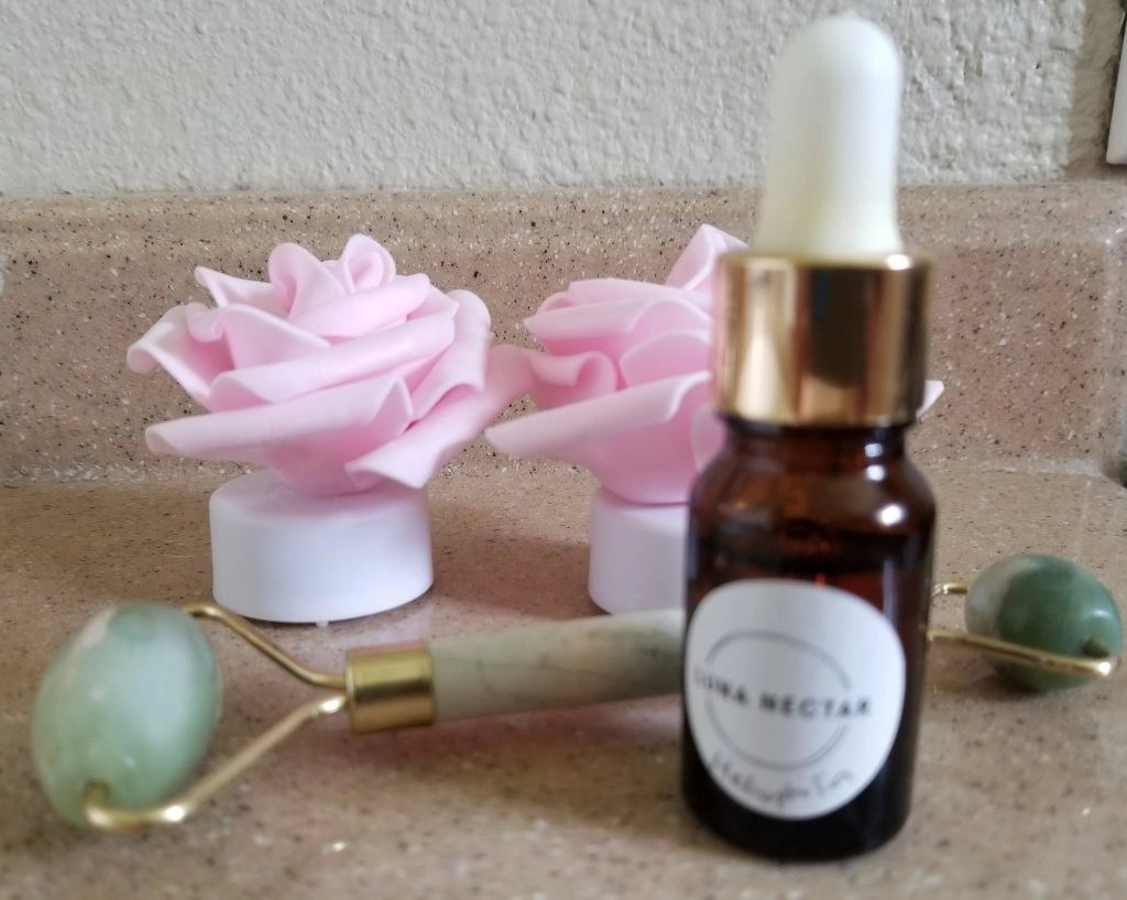 Metamorphic Jade Roller and Heliophilia Glow and Fix Serum