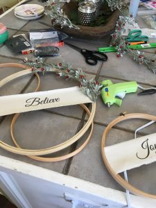 Learn how to create beautiful Christmas Hoop Wreaths to display in your home during the holiday season. The perfect DIY for those of a budget.