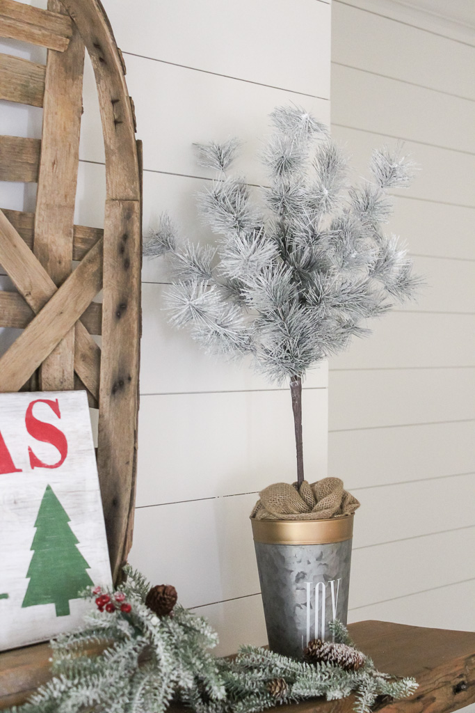 A step by step for how to make Christmas Topiaries. These are simple and cheap to make and add such charm to your farmhouse decor.