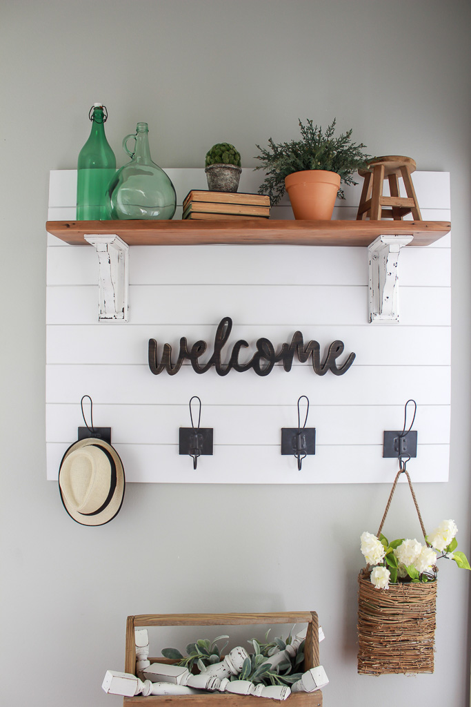 Learn how to make your very own farmhouse style shiplap coat rack with easy step-by-step instructions. Make Chip & Joanna proud with this fixer upper inspired project.
