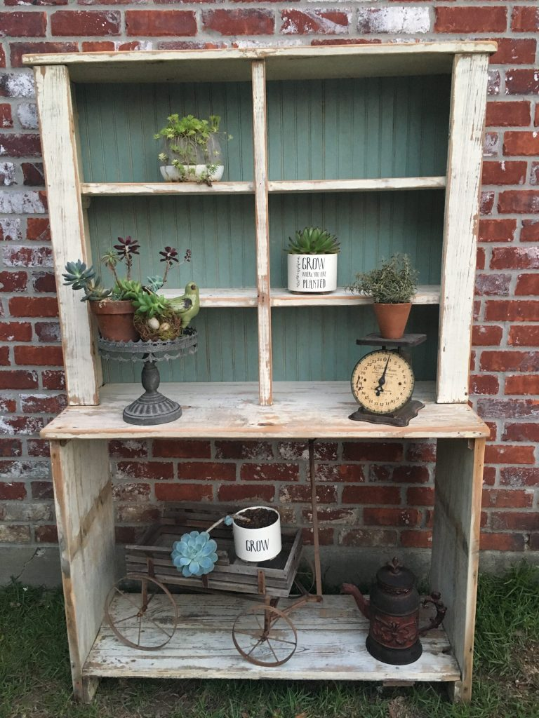 Learn how I created my own vintage style potting bench by using a primitive table and chippy white cabinet. I used clay pots and vintage pieces to complete the look.