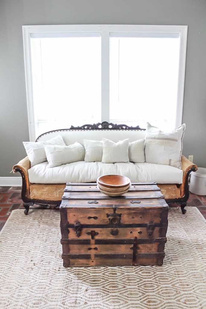 """A step by step tutorial on how to get a deconstructed sofa look. Starting from tearing it down to its """"bones"""" and then recovering it with drop cloth for a deconstructed sofa look."""
