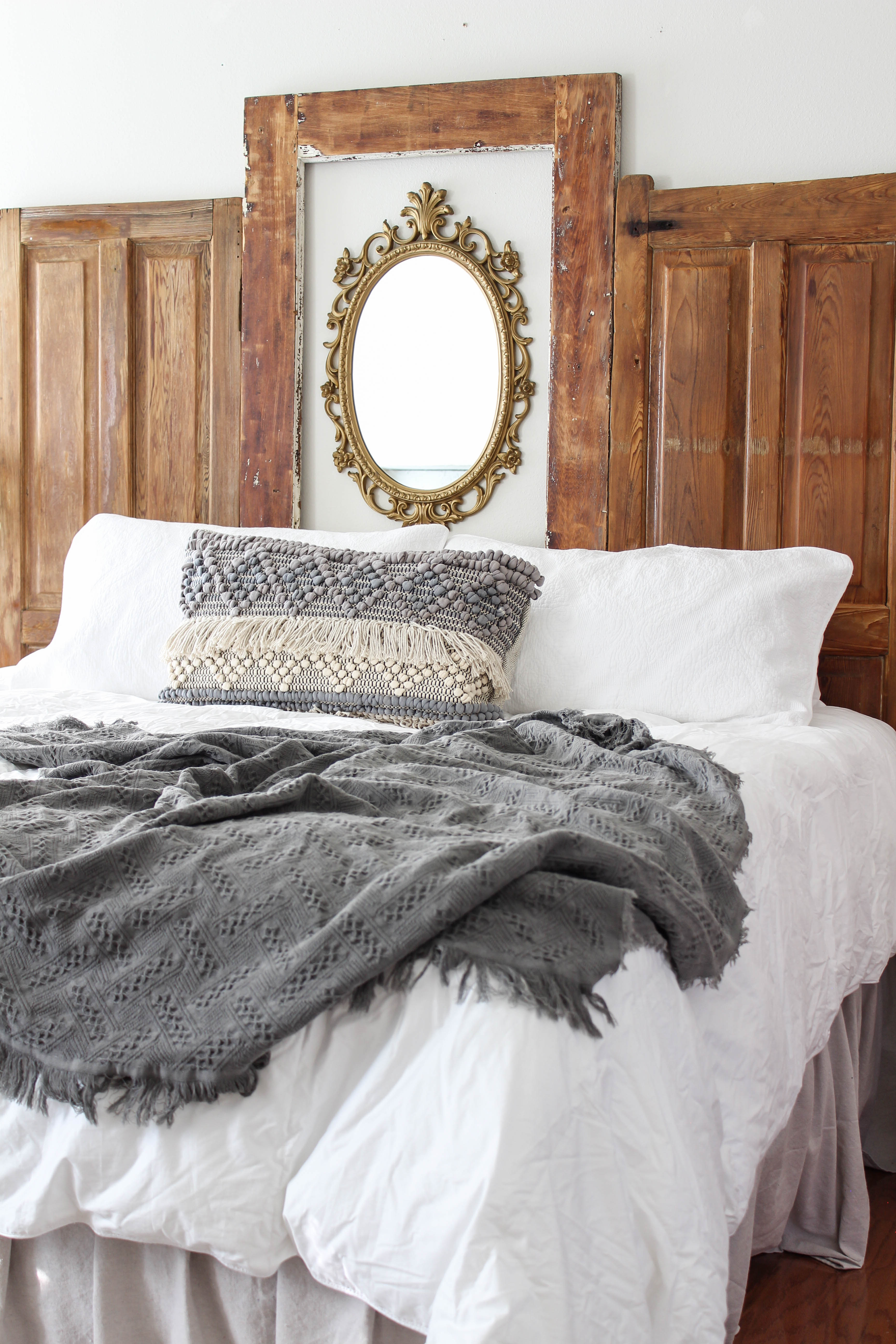 A step by step tutorial for creating a DIY headboard and bed frame using vintage doors. A budget friendly project that can transform your bedroom!
