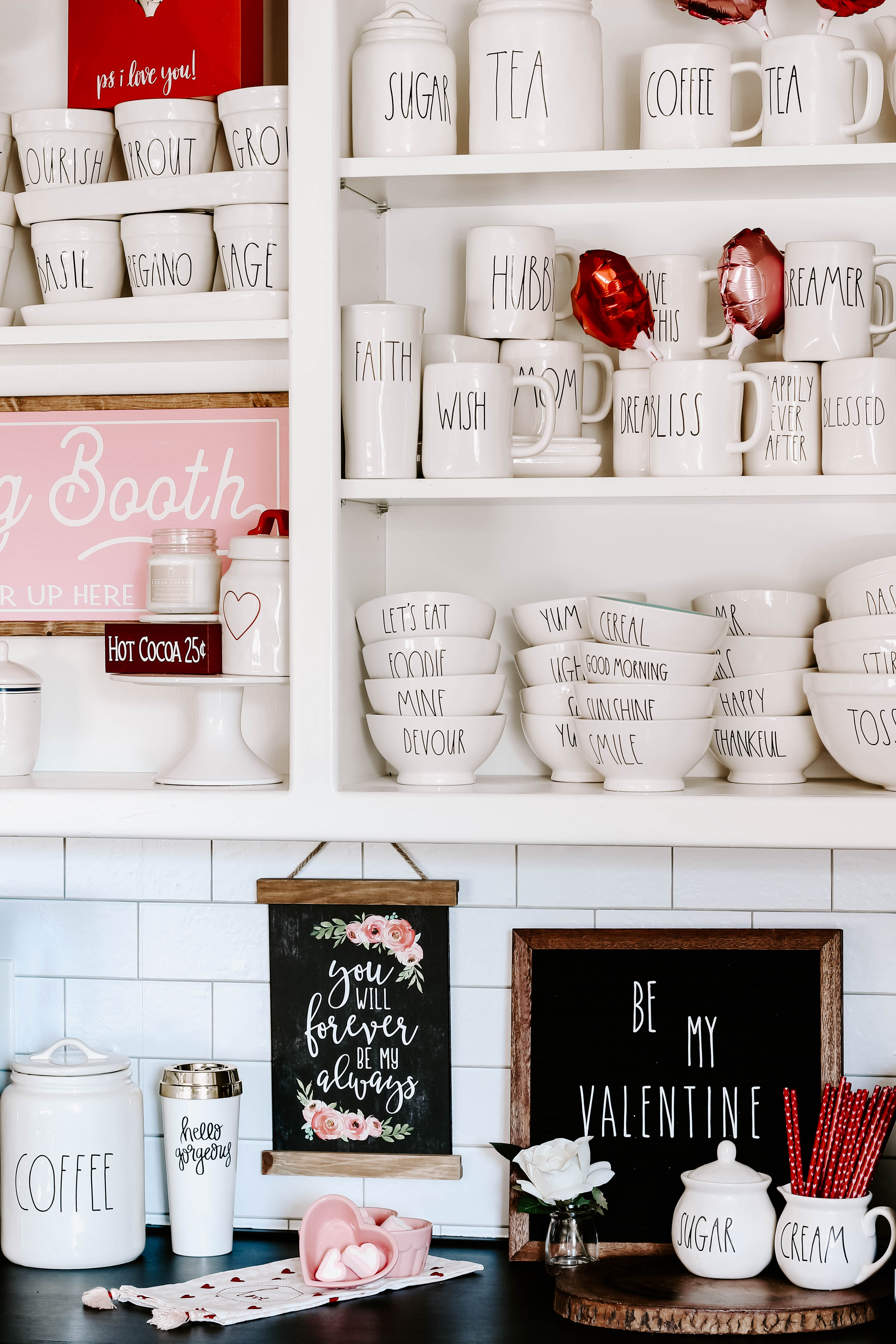 See how I created a farmhouse style Valentine coffee bar with lots of Rae Dunn and small touches of pink and red Valentine decor.
