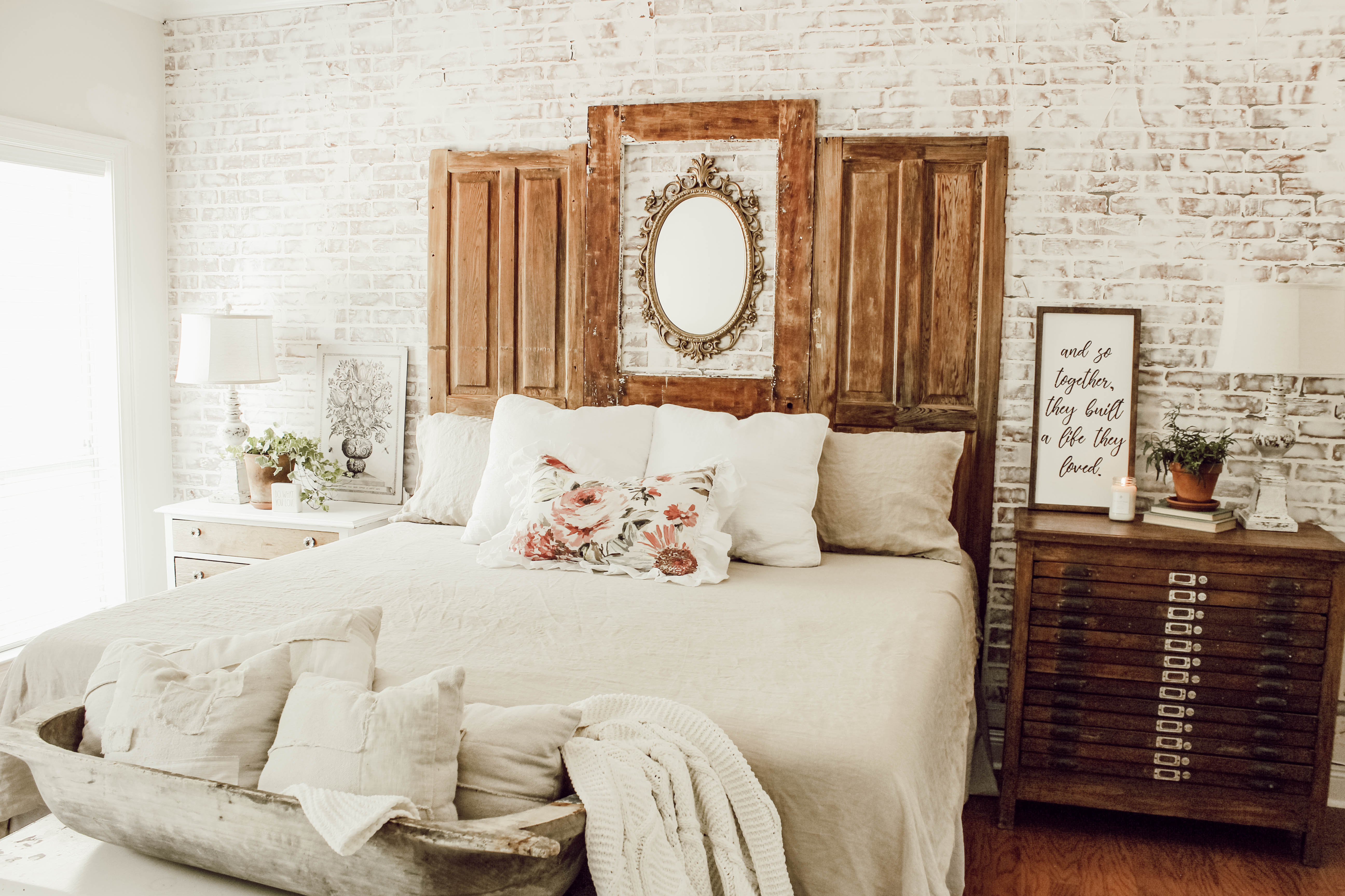 Sharing the details of a summer bedroom makeover, including a faux brick wall, vintage decor, a DIY headboard and linen duvet.