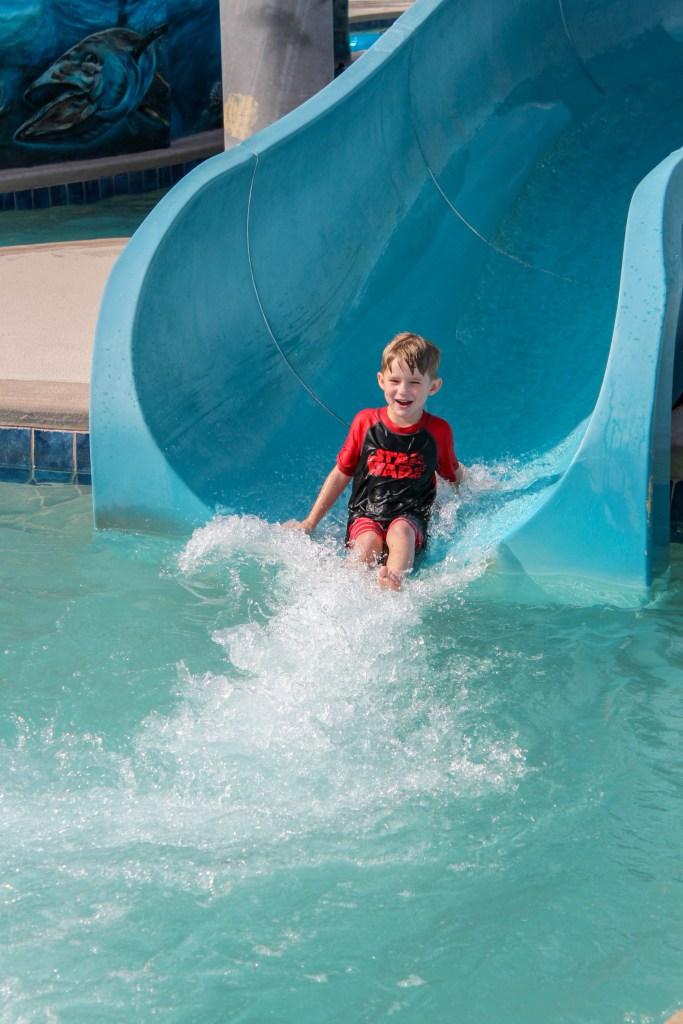 kid on waterslide at Resort