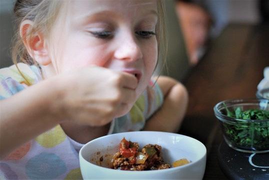 child enjoying chili