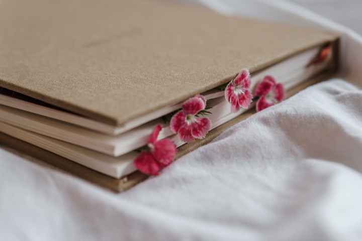diary with flowers between pages on crumpled fabric