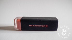 Max Factor lipstick in 05 Nude, a brand new product, hygiene seal intact, used to verify the integrity of the experiment.