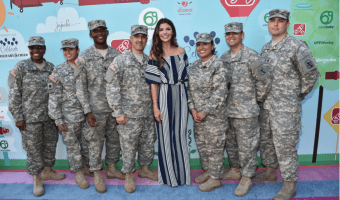 ali landry with military troops on a rainbow carpet at the 5th annual celebrity red carpet event at sony studios california