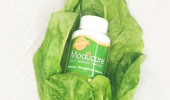 moducare wrapped ini lettuce on a white background