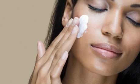 Woman using Skin lightening cream