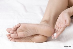 Applying cream to feet