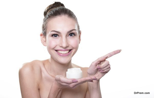 young woman face show cream