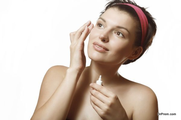 A woman uses a cream. Caring for mature skin.