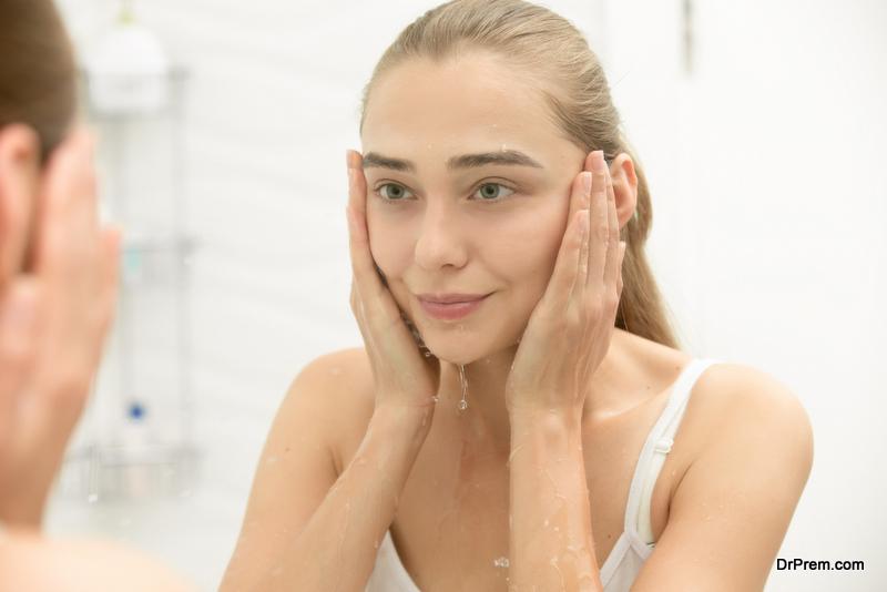 woman washing face at night