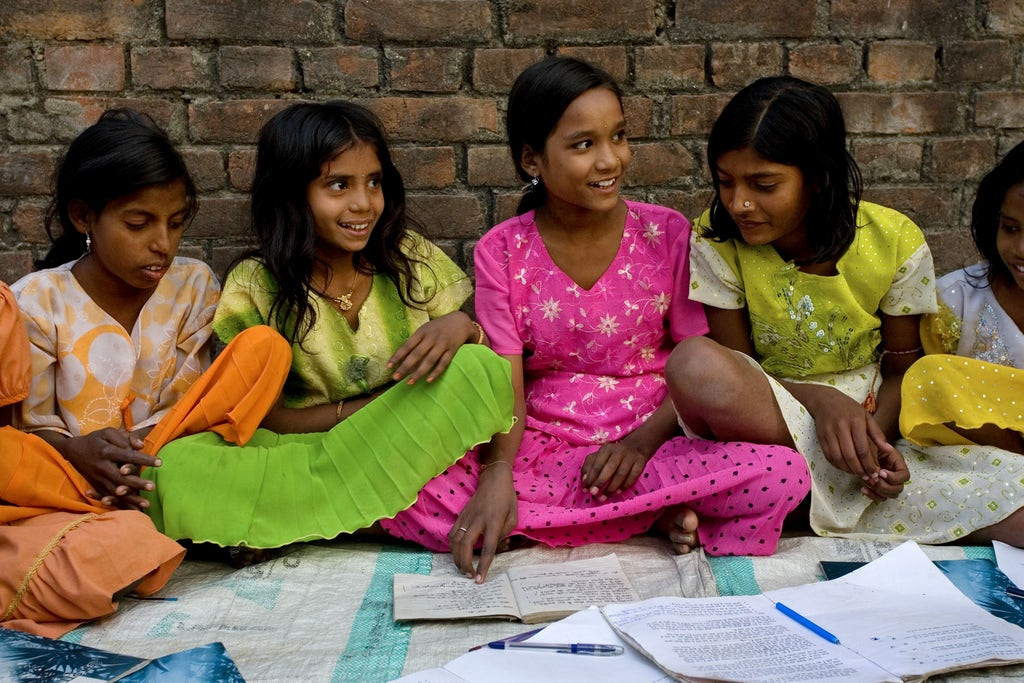 A group studying the spiritual empowerment of junior youth in Biharsharif, India