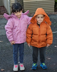2 children with new warm coats