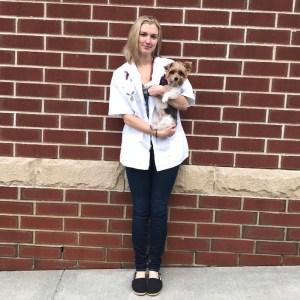 Dr. Carolyn Emery holding dog