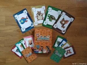 caja y cartas del juego de mesa Mascotas de Átomo Games