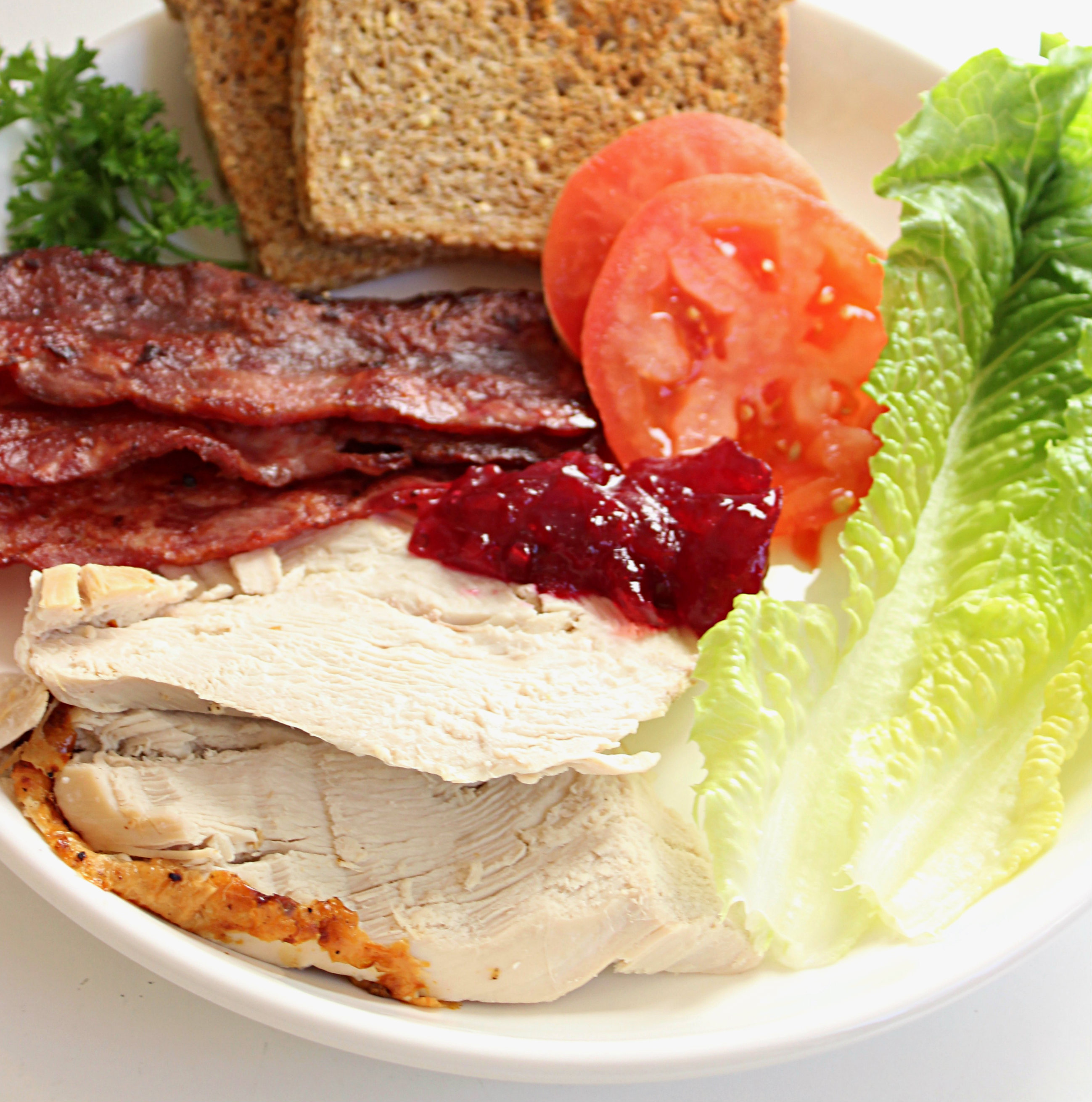 Leftover Turkey: Club Sandwich with veganaise, sprouted spread, turkey bacon and cranberry sauce.