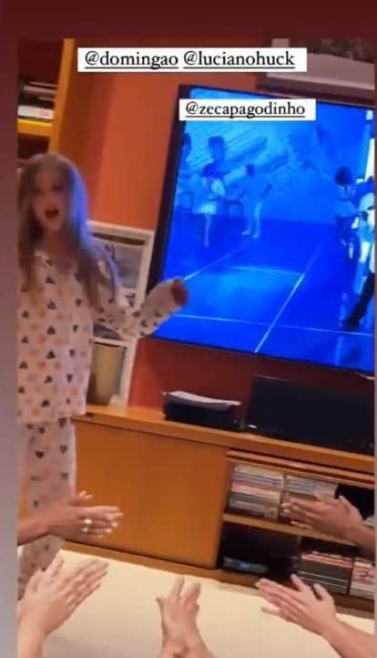 Angelica showing her daughter in her giant TV room