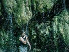 woman at mainit hot spring falls philippines