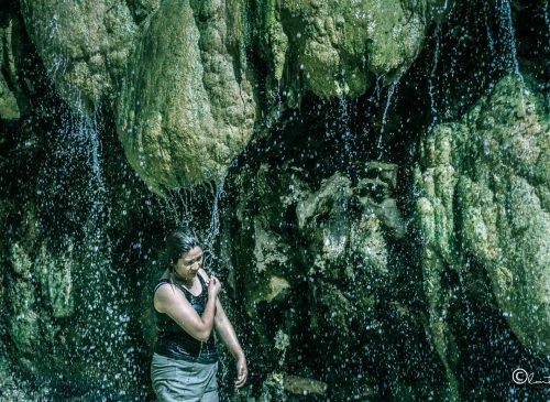 woman at mainit hot spring falls philippines