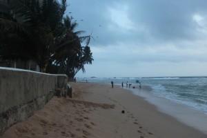 Walk along Hikkaduwa Beach at dusk