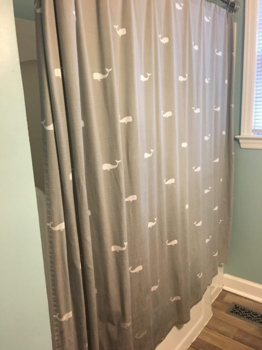Cleaned, repaired, and re-hung: a second life for this shower curtain.
