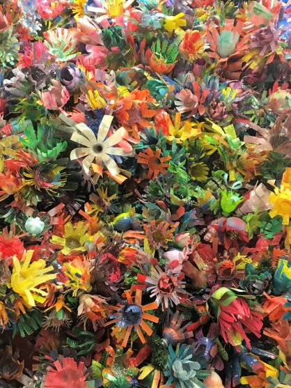 Close up image of flowers created from plastic bottles at the Creative Discovery Museum