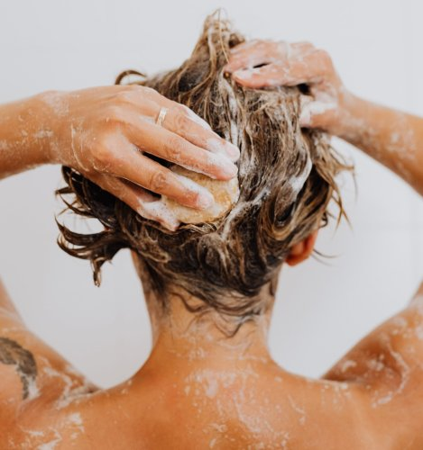 Person washing hair in shower