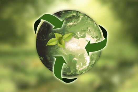 Image of a green earth with green recycling arrows