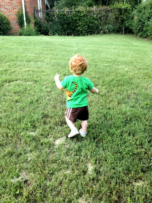 My son playing in the yard of our new home