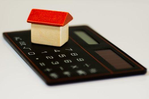 Small house figure on a calculator