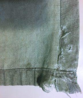 Corner of curtain, falling apart