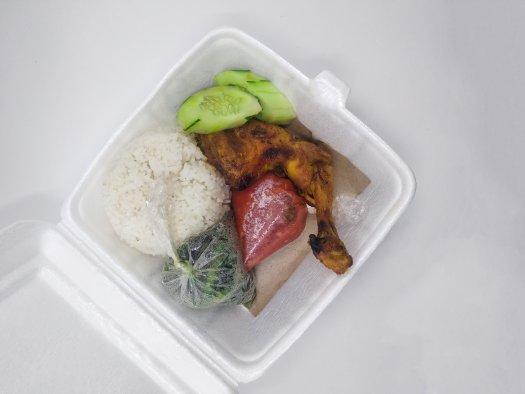 Chicken, rice, and vegetables in polystyrene container