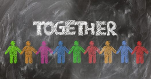 """Chalkboard drawing with the word """"Together"""" and people figures in different colors."""