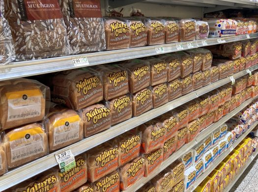Angled photo of the bread aisle at the supermarket.