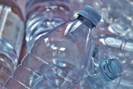 Close-up of clear blue water bottles