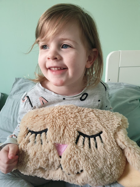 3 year old girl with Lamby Dream Pillow