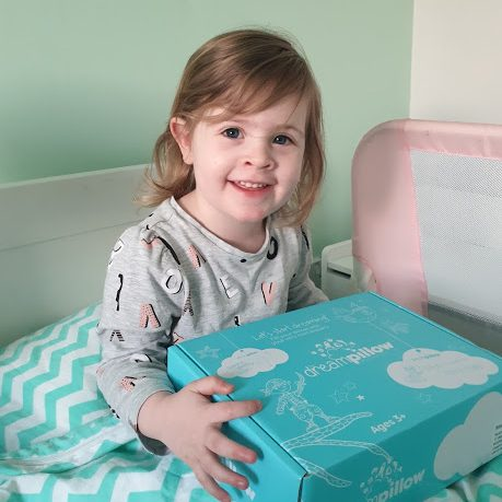 3 year old girl with Dream Pillow box