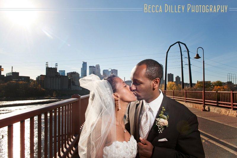 Modern Minneapolis ethiopian wedding couple portraits on stone arch bridge