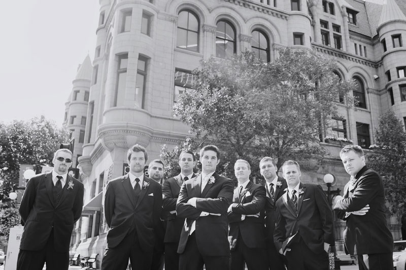 casual photo of groomsmen looking tough at Rice Park, St Paul