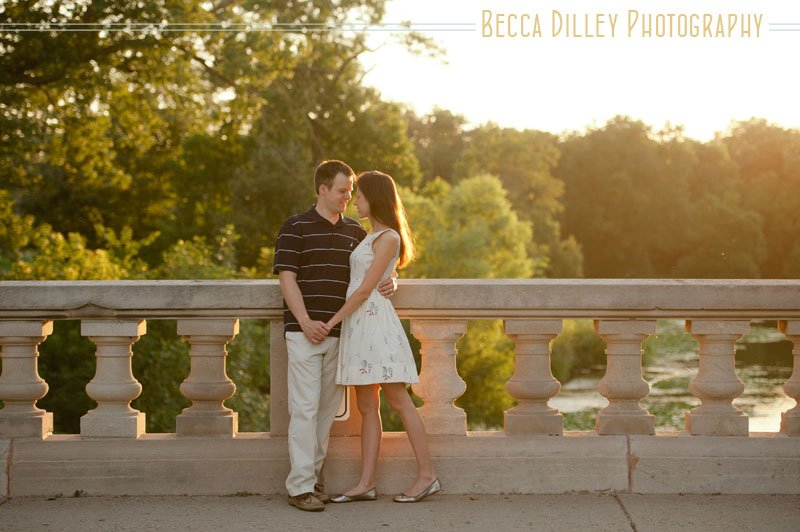 minneapolis couple portraits at lake of the isles standing on bridge