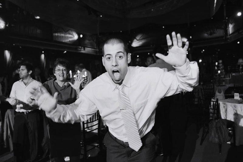 groomsman with funny face at varsity theater wedding minneapolis