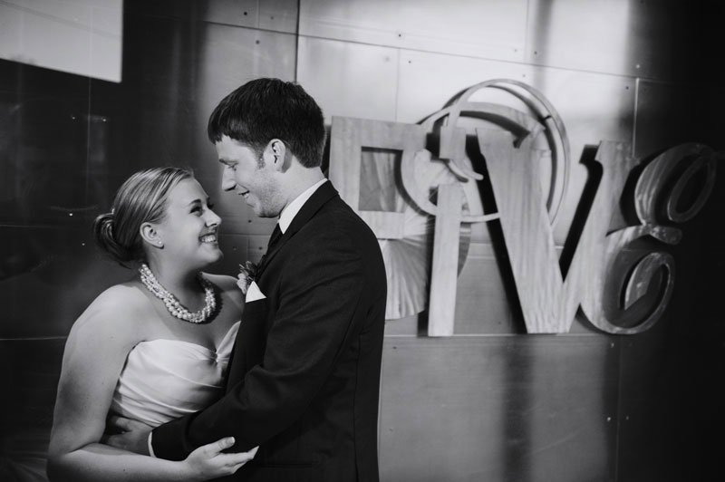 bride and groom in front of five event center sign minneapolis mn