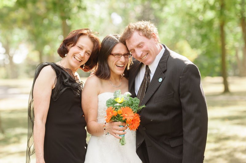 bride with parents laughing at Lake Hiawatha for Minneapolis wedding