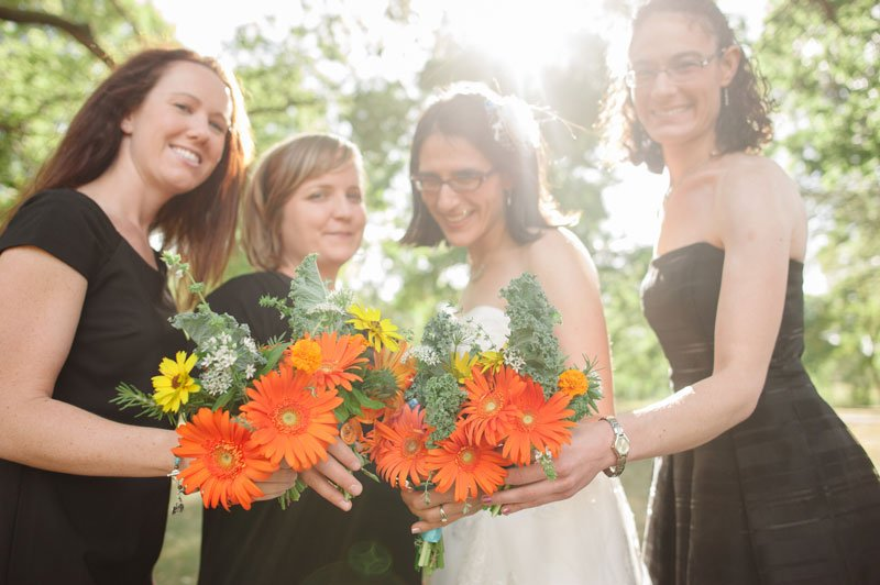 bride with bridesmaids and homegrown bouquets of kale and gerbera daisys